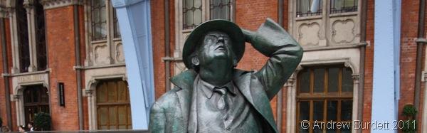 WELL BLOW ME_Sir John Betjeman's statue at St Pancras Railway Station.