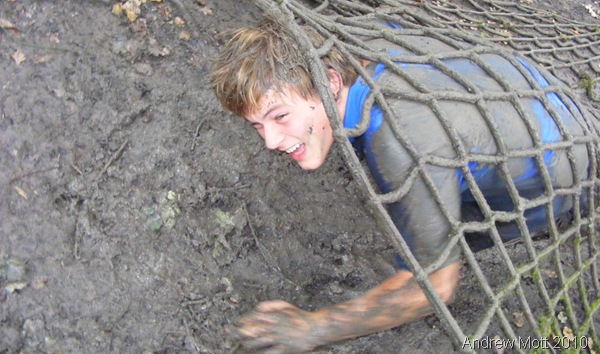MUCKING AROUND_Me surrounded by thick Welsh mud, during a training camp in September 2010.