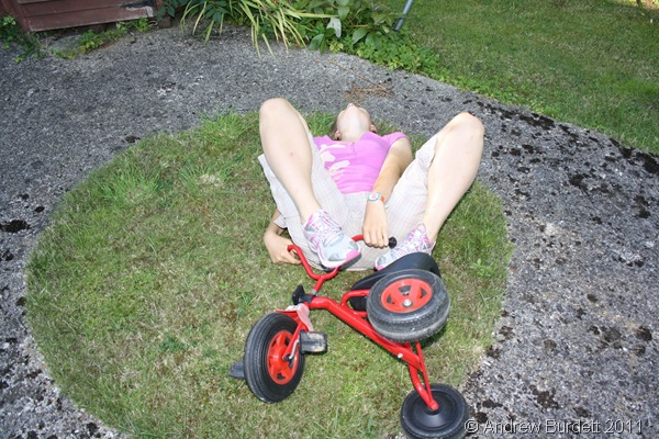SPIN-OUT_Harriet fell off the trike on the grassy path in the middle of the 'roundabout'.