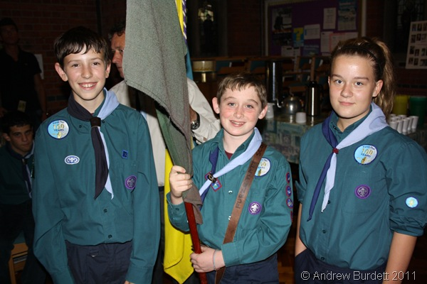 DOING THEIR DUTY_Three Scouts carried the flags up at the start of the service.