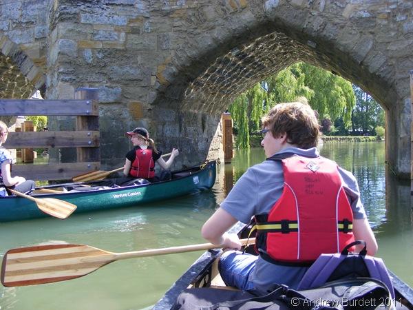 UNDER THE BRIDGE_The fleet of boats pass under a bridge en-route.