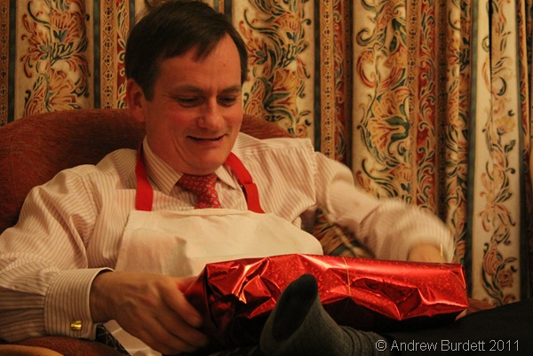I WONDER WHAT IT IS_Dad likes to guess what's in the parcel before he undoes the bow.