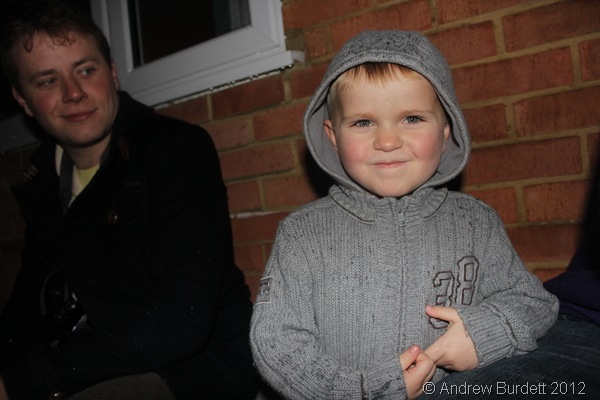 CHEEKY CHAPPY: A youngster looks on at the fireworks outside. (IMG_1135)