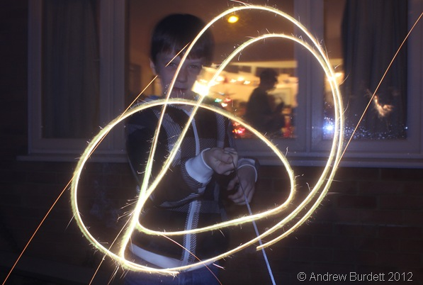 BRIGHT SPARK: Rhys Bartholomew plays with a sparkler. (IMG_1185)