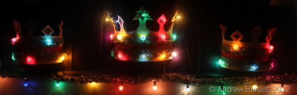 CROWNING GLORY: Three crowns, each illuminated with fairy lights, hang on the wall. (IMG_1543)