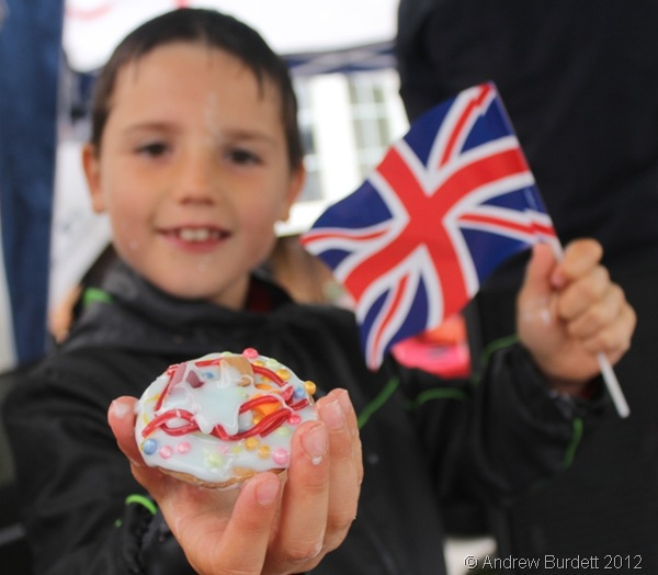 LOOK WHAT I MADE: Gregor holds his Diamond Jubilee self-iced biscuit proudly. (084_IMG_4290_ARB)