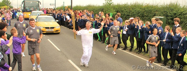 HERE IT IS: Furze Platt Senior School pupils lined the banks of the road to watch as the Torch passed the school. (IMG_8810_ARB-edited)