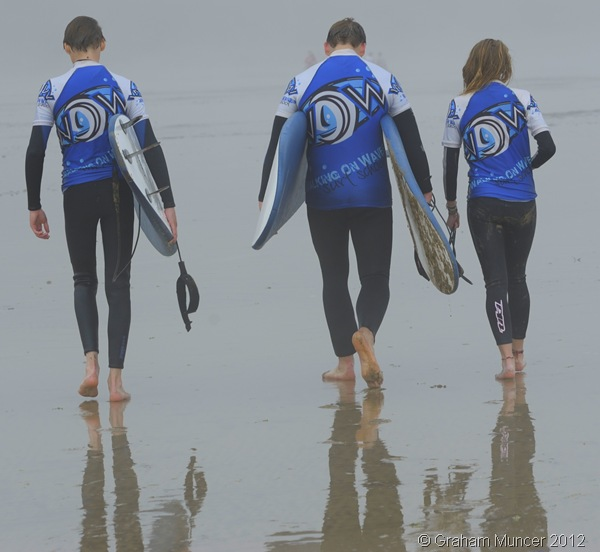 INTO THE MIST: Josh, me, and Madi walk up the foggy beach with our boards. Actually, Madi made me carry hers for her, though she helpfully volunteered to 'lug' the strap. (0778_20120808_DSC3574_GrahamMuncer)
