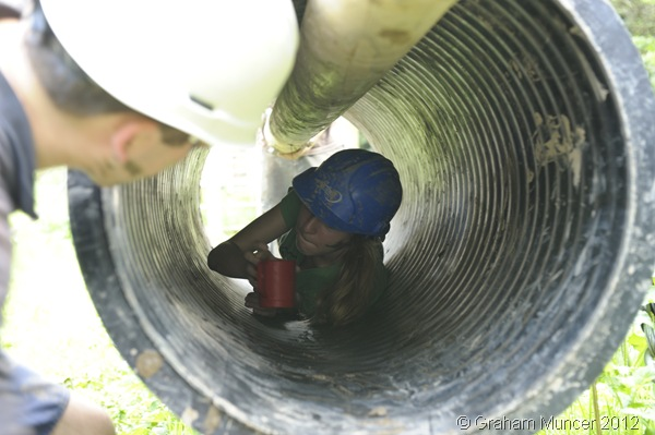 CUP RELAY: Madi crawling through the tube, during one section of the assault course, before passing the cup to the waiting me. (1041_20120809_DSC3672_GrahamMuncer)