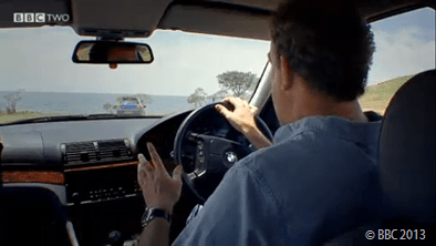 FACING THE LAKE: Jeremy Clarkson realises there's a problem with the challenge - they seem to complete it in minutes.