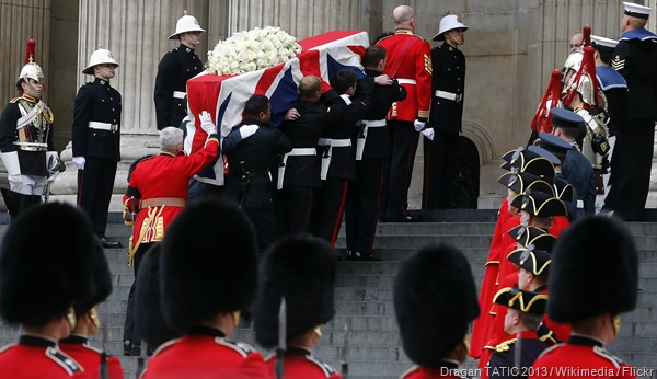 UP SHE GOES: Margaret Thatcher's Union-Flag-draped coffin enters St Paul's.
