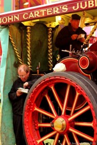 PLOUGHMAN'S LUNCH: A steam tractor engineer engrosses himself in his lunch.