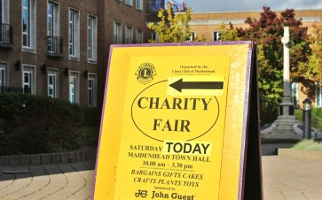 Sign pointing to the Lions Club's Charity Fair in Maidenhead Town Hall.