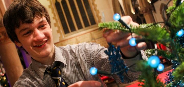 Matt Price helps decorate the Taplow Youth Choir Christmas tree