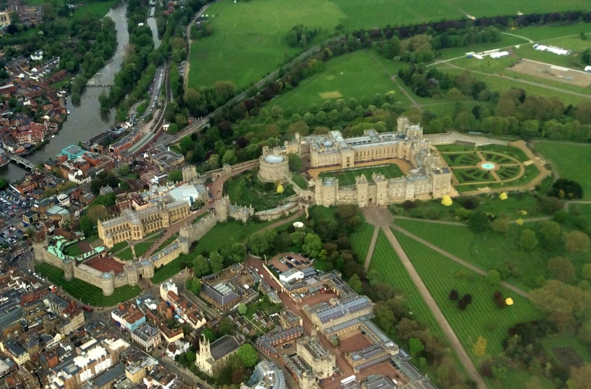 The Queens Scout Award ceremony, seen from the Heathrow flight-path. Observe the tiny row of uniformed Scouts standing on the grass within the Castle's walls.