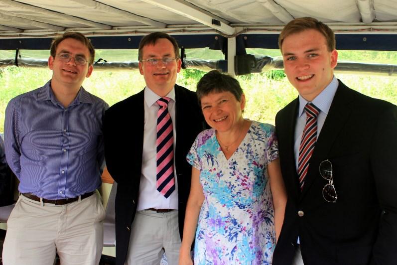 On board the boat: Matthew, Richard, Ann, and Andrew Burdett.
