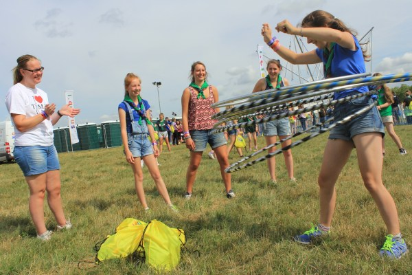Guides from the East Lothian group wiggle hula hoops.