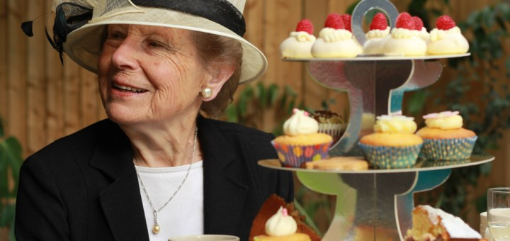 Ann Hockham enjoying the pleasant atmosphere of the vicarage garden party in August 2014.