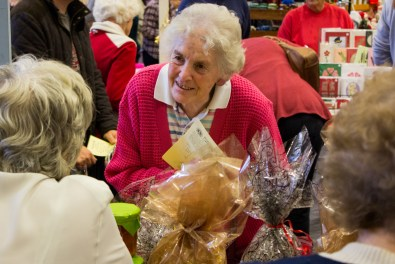 Enid Barber, a St Luke's congregation member, catches up with one of the ladies on the church's stall.