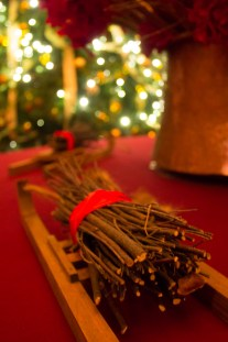 Twigs, bundled like logs on a miniature sledge, decorate a table in one of the rooms at Waddesdon.