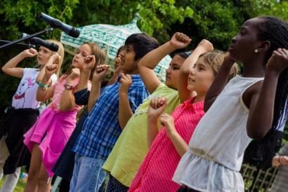 St Luke's schoolchildren entertained with actions alongside their singers.