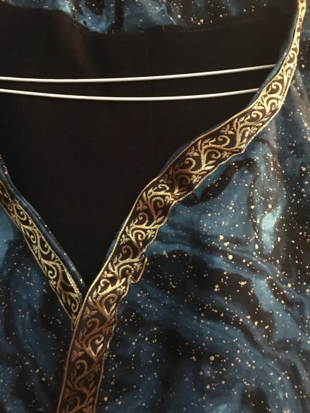 Golden trim on a fabric with interstellar space prints
