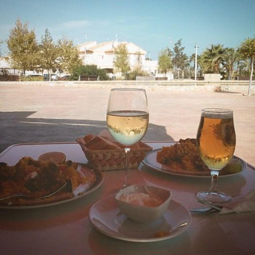 Paella, wine, beer, alioli sauce and bread.