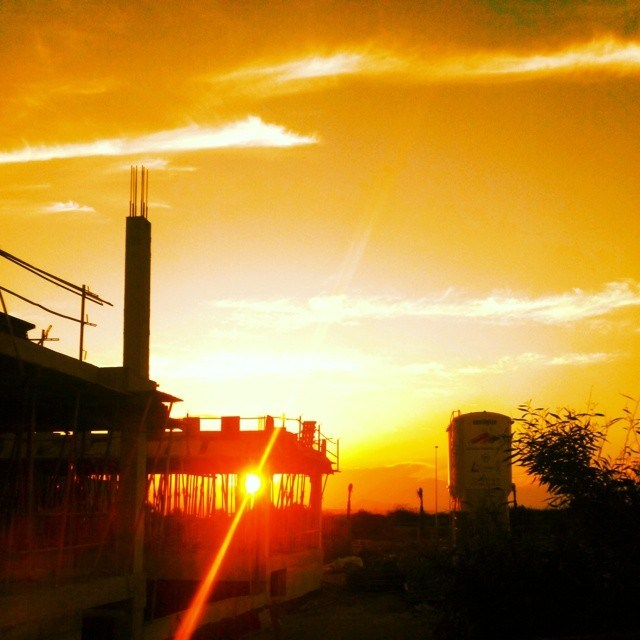 Sunset over a construction site, Torrevieja, Spain. June, 29, 2014