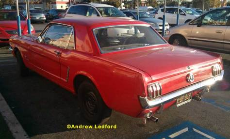 65 Red Mustang At Store Parking Lot