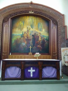 'The Ascension', painting by W. P. Starmer ((1871–1961) above the main altar in the church of St Aldhelm, London N18 (W. D. Caroe, 1903), in 2017.