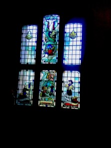 Stained glass (1947-8) by W. P Starmer (1871–1961) on the north side of the west wall of St Aldhelm's church, London N18, in 2017.