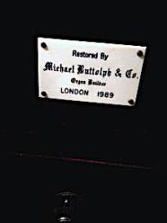The organ in St Barnabas Southfields, London UK; builder's plate.