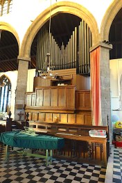 The organ in St Barnabas Southfields, viewed from the chancel. Source: London Churches in Photographs https://londonchurchbuildings.com