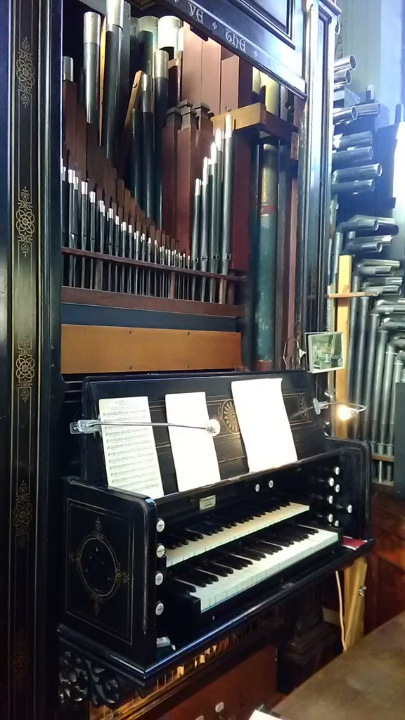 Console and pipe-work of the west-gallery pipe organ, church of Our Most Holy Redeemer & St Thomas More, Chelsea, London (UK)