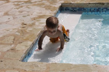 Tommy loved being able to play on the steps with water.