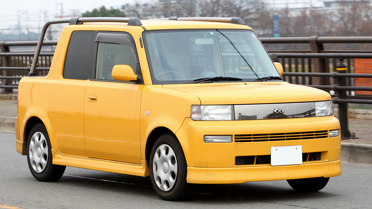 hight resolution of picture of the front view of a yellow toyota bb open deck