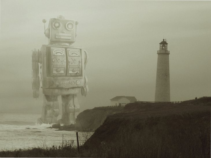 Digital collage of toy robot marching through the ocean towards a lighthouse by Andrew Tong Art