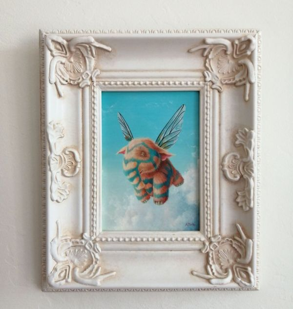 Framed painting of flying elephant with stripes