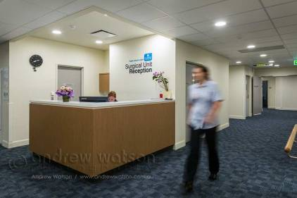 Image of staff walking through private hospital reception area