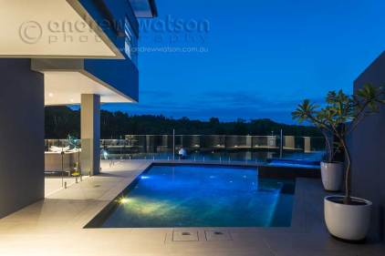 Twilight image of waterfront home in Bluewater, Cairns