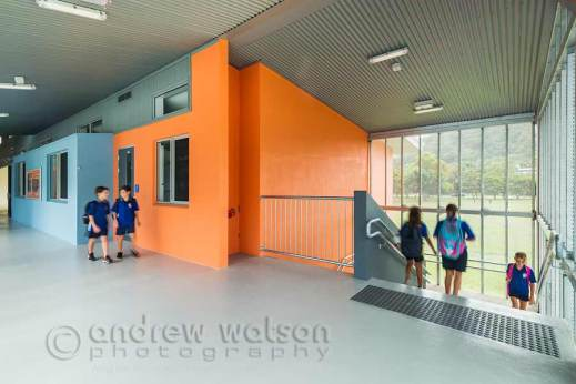 Image of school children walking through hallway and down stairs