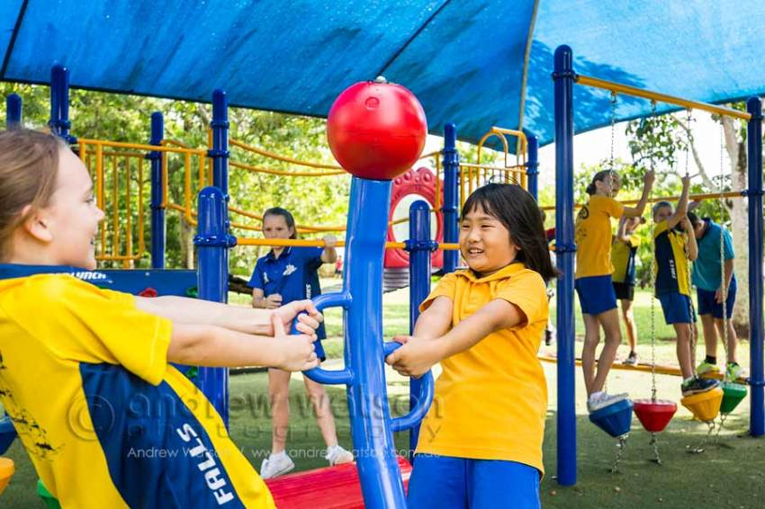 Image of school kids having fun in a playground