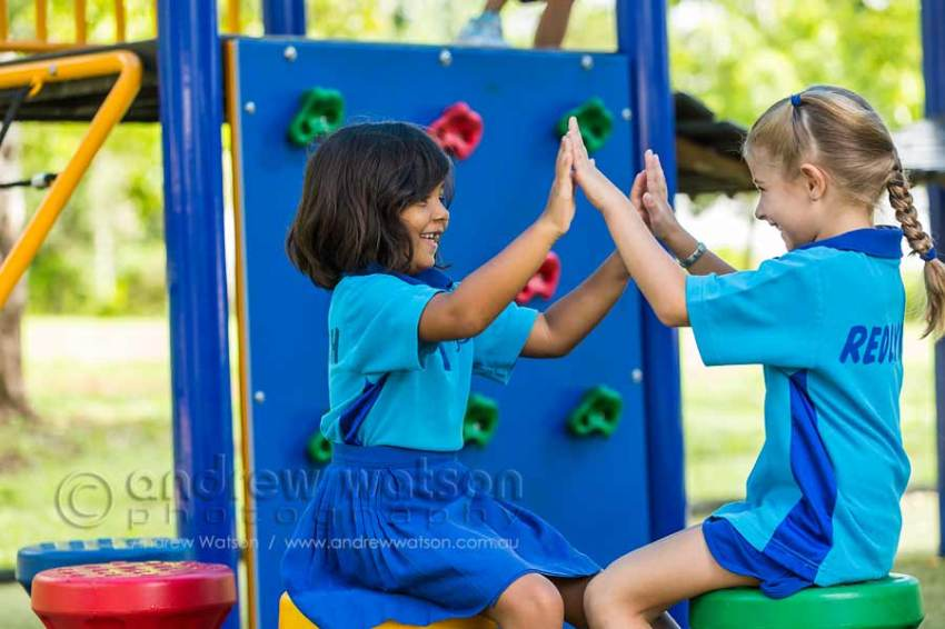 Image of young school girls playing in playground