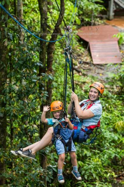 Image of mother and young child on rainforest zipline in Daintree