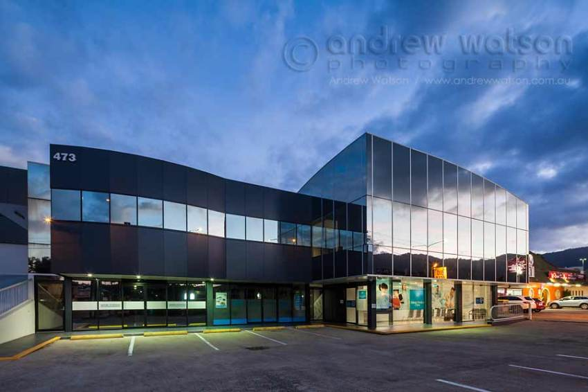 Twilight image of Abbott Medical Clinic building at night