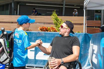 Image of Dylan Alcott with kids at ANZ tennis clinic in Cairns