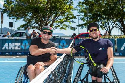 Image of Dylan Alcott and business member at Cairns Tennis Charity Challenge