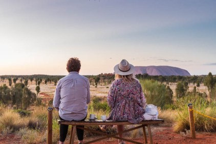 Image of visitors watching the sunrise at Uluru