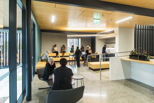 Staff sitting around lunch and social hub in arts building