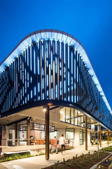 The digital facade Bulmba-ja Arts Centre illuminated at twilight